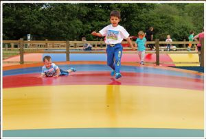Children playing outdoors on Air Bouncers Jumping Pillows