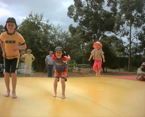 Children playing on Jumping Pillow Air Bouncer