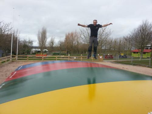 Adult Jumping on Air Bouncer